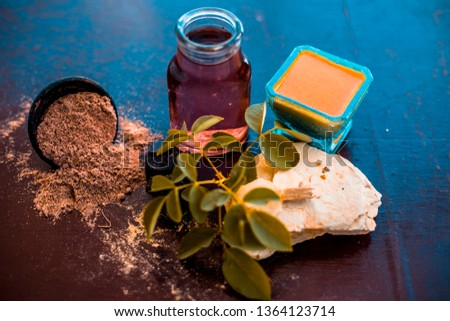 Face pack of devil's dung powder on wooden surface i.e. Hing powder well mixed with mulpani mitti or fuller's earth and rose water.Used for the treatment of Acne and pimples. Photo stock ©