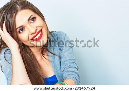 Face portrait of smiling girl. Female model studio portrait.