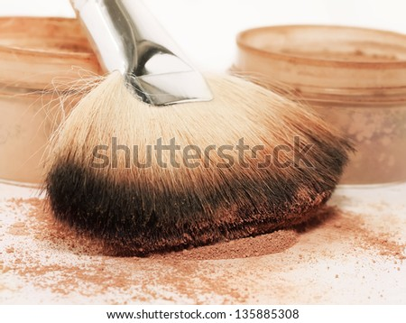 Face powder and brush. macro