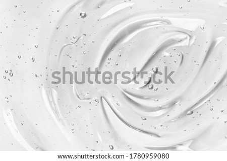 Face serum or gel texture. Clear skincare cream with bubbles background. Transparent cosmetic gel product strokes closeup