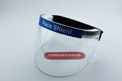 Face shield on a white background. Pandemic COVID-19 virus and protection against coronavirus concept.
