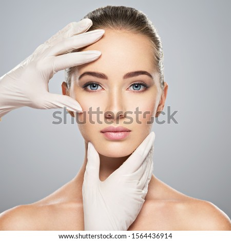 Face skin check before plastic surgery. Beautician touching woman face. Foto stock ©