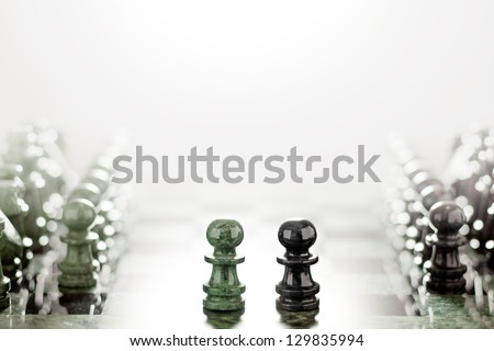 Face to face like wall and axe. First move: two pawns opposition in the middle of the board.