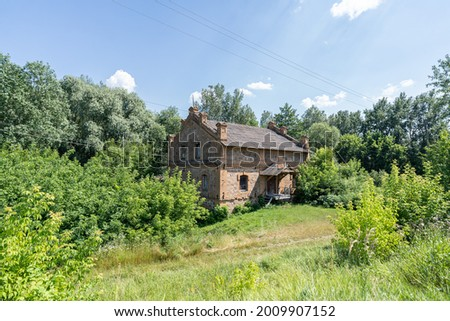 Face view of the eighteenth-century abandoned water mill building. Сток-фото ©