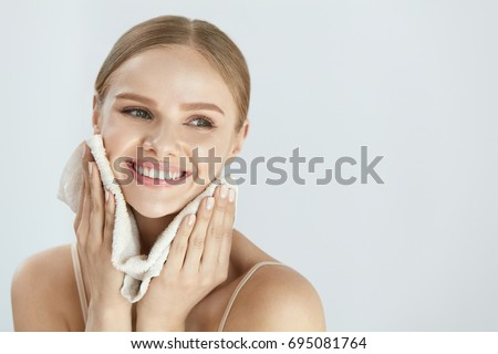 Face Washing. Closeup Of Happy Woman Drying Skin With Towel. High Resolution #695081764