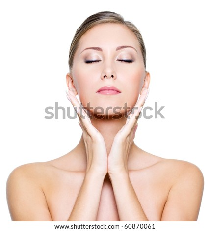 Face with closed eyes of a sexy beautiful young woman with clean skin on a white background