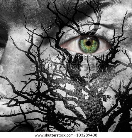 Face with green eye painted with medusa like tree