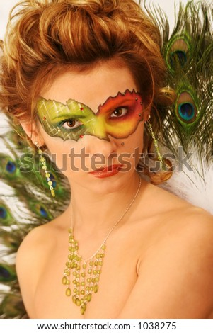 stock photo : face with multicolored makeup and peacock's fun