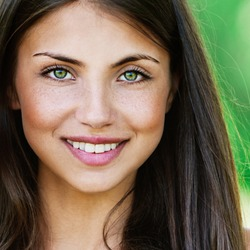 Face young beautiful girl dark closeups short hair summer park smiling