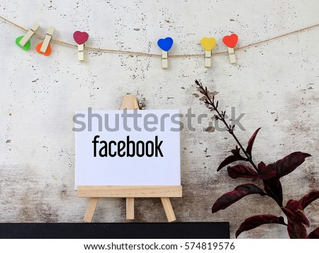 Facebook - business concept words on canvas stand. rustic wooden background