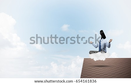 Faceless businessman with camera zoom instead of head sitting in lotus pose #654161836