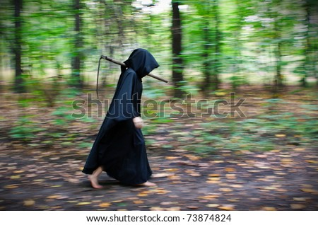 Faceless Death in black robe with scythe walking through the forest