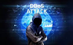 Faceless hacker at work with DDoS ATTACK inscription, Computer security concept