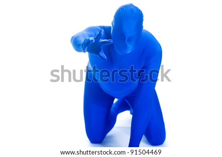 Faceless man in a blue body suit on his hands and knees begging for help.