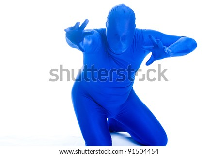 Faceless man in a blue body suit reaching out toward the camera.