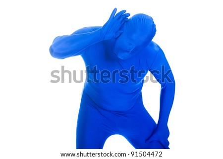 Faceless man in a blue body suit trying to hear - stock photo