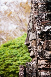 Faces of ancient Bayon temple popular tourist attraction in Angkor Thom, Siem Reap, Cambodia
