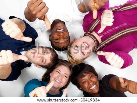 faces of smiling multi-racial college students/friends with their thumbs up