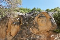Faces sculpted in the rock on the Ruta de las Caras de Buendía. Basin. Castilla la Mancha. Spain
