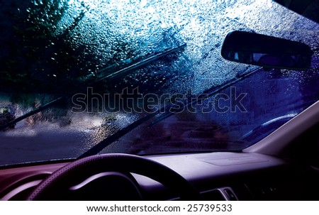 facia of the car and drops on the windshield