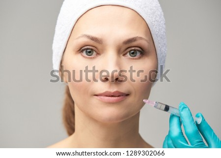 Facial injecting treatment. Skin platelet. Prp rich plasma injection. Beauty woman. Doctor gloves. #1289302066