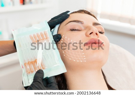 Facial lifting thread. Thread facelift with arrows on face for woman's skin, procedure facial contouring using mesothreads. Close up. Concept of plastic surgery. Сток-фото ©