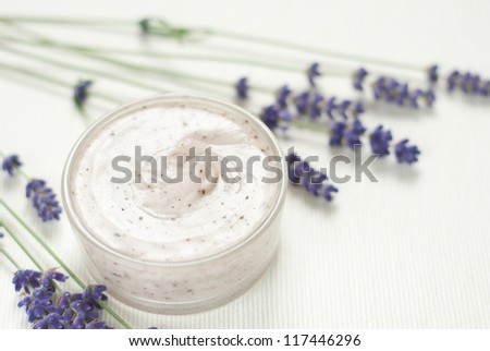 facial mask, blue lavender flowers on white textile background