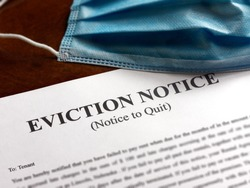 facial or surgical mask on top of the eviction note