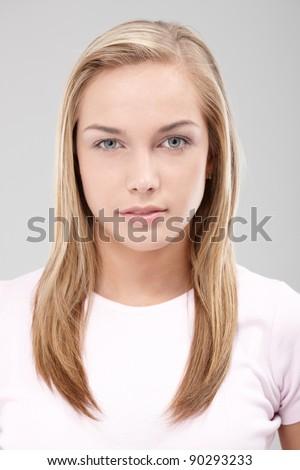 Facial portrait of natural beauty looking at camera, small smile.?