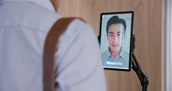 facial recognition concept - Asian businessman using face scanner to clock in work and check body temperature then unlock office door