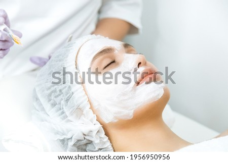 Facial skin care and protection. A young woman at a beauticians appointment. Сток-фото ©