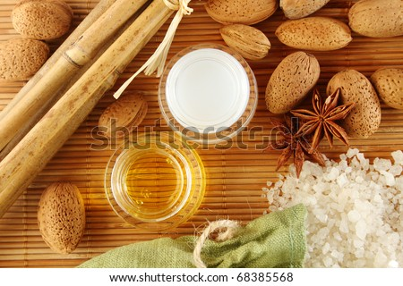 Facilities for body care in a fabric bag of bath salts, related to bamboo sticks, star anise, nuts, almonds, and two jars of cream and butter