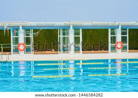 Facilities of an indoor pool in winter and outdoor in summer.