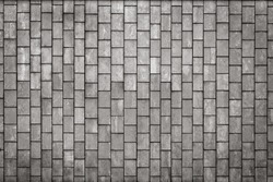 Facing gray tiles as a vintage background