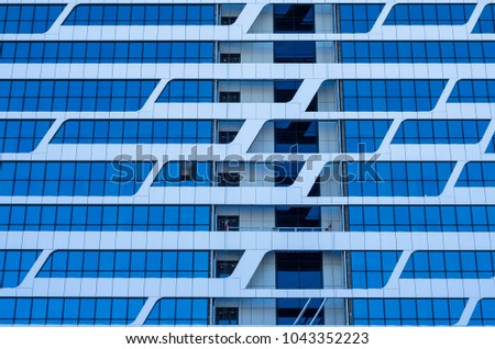 Facing the building with a ventilated facade. Aluminum colored facades. Modern facades of high-rise buildings. Construction of a large residential complex. #1043352223