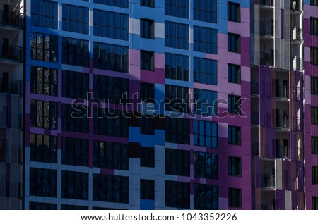 Facing the building with a ventilated facade. Aluminum colored facades. Modern facades of high-rise buildings. Construction of a large residential complex. #1043352226