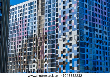 Facing the building with a ventilated facade. Aluminum colored facades. Modern facades of high-rise buildings. Construction of a large residential complex. #1043352232