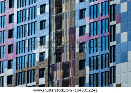 Facing the building with a ventilated facade. Aluminum colored facades. Modern facades of high-rise buildings. Construction of a large residential complex. #1043352241