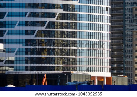 Facing the building with a ventilated facade. Aluminum colored facades. Modern facades of high-rise buildings. Construction of a large residential complex. #1043352535