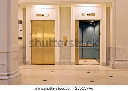 facing twin elevators on first floor, one is open