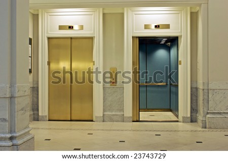 facing twin elevators on first floor, one is open