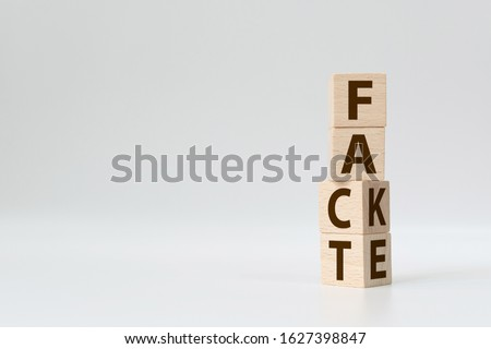 Fact or Fake concept, Wooden cube change the word, April fools day Photo stock ©