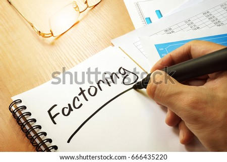 Factoring written by hand in a note.