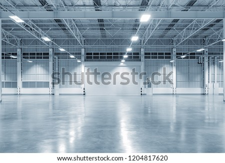 Factory building or warehouse building with concrete floor for industry background.