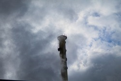 factory chimney venting fumes polluting planet earth and the ozone layer