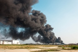 factory fire burning with black smoke