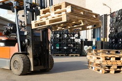 Factory Forklift Truck Stacker Transporting Pallets at Plant Warehouse