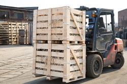 Factory Forklift Truck Stacker Transporting Wood Cargo Boxes with Products to Plant Warehouse