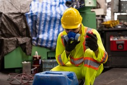 Factory male worker wear safety uniform and safety gas mask opening chemical tank at the industry factory. Chemical specialist wear safety gas mask working and checking chemical tank at work factory