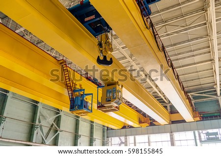factory overhead crane on a yellow beam Close up #598155845